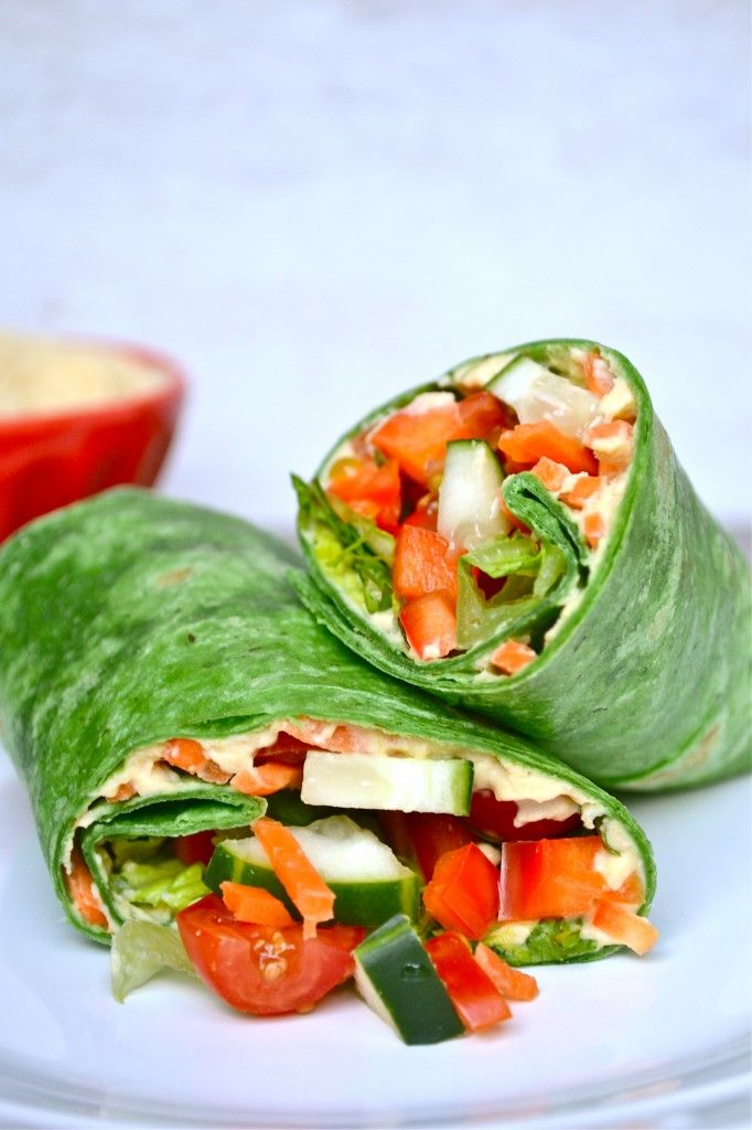 Vegetable Hummus Wrap: Ingredients Spinach Wrap (or wrap of your choice) Hummus (I used traditional, but any flavor will do) Cucumber, diced Red pepper, diced Shredded Carrots Tomato, diced Lettuce, shredded