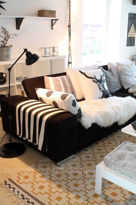 sheepskin softness don 39 t like the black sofa though interiors pinterest living rooms. Black Bedroom Furniture Sets. Home Design Ideas