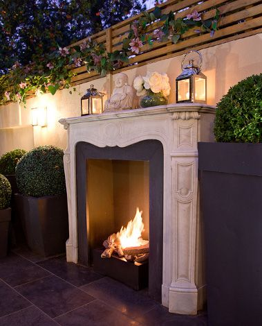 Outdoor fireplace- this is just gorgeous More