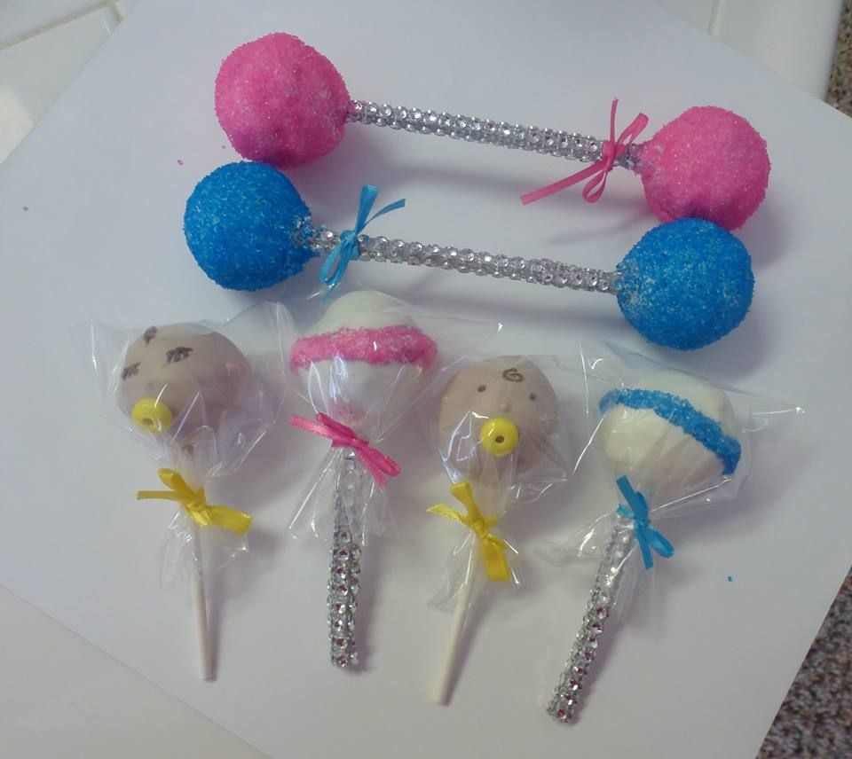 Baby rattles and baby cake pops.