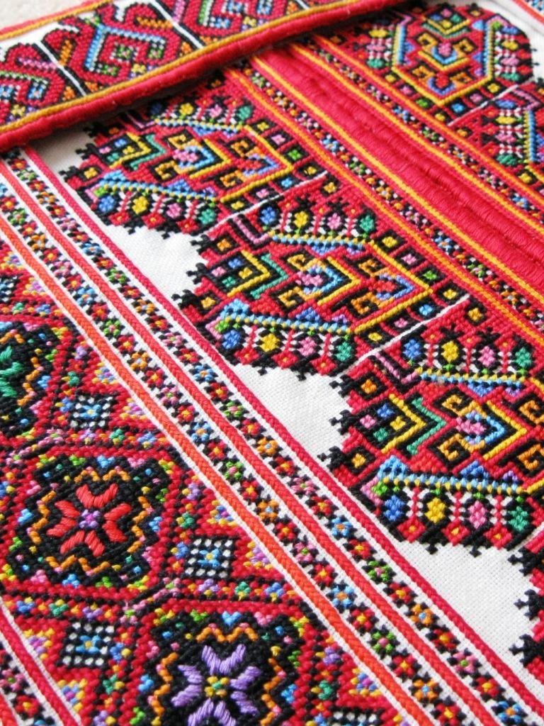 Details of embroidered collar, cuff, and chest panels for a man's traditional Ukrainian 'sorochka', or shirt, in the style of Horodenka region villages of Yaseniv-Pil'nyi, Chernyatyn, Tyshkivtsi, Chortovets, Korniv, Balyntsi, and Kotykivka, from Carpathian Western Ukraine (Hand embroidered by Dave Melnychuk)