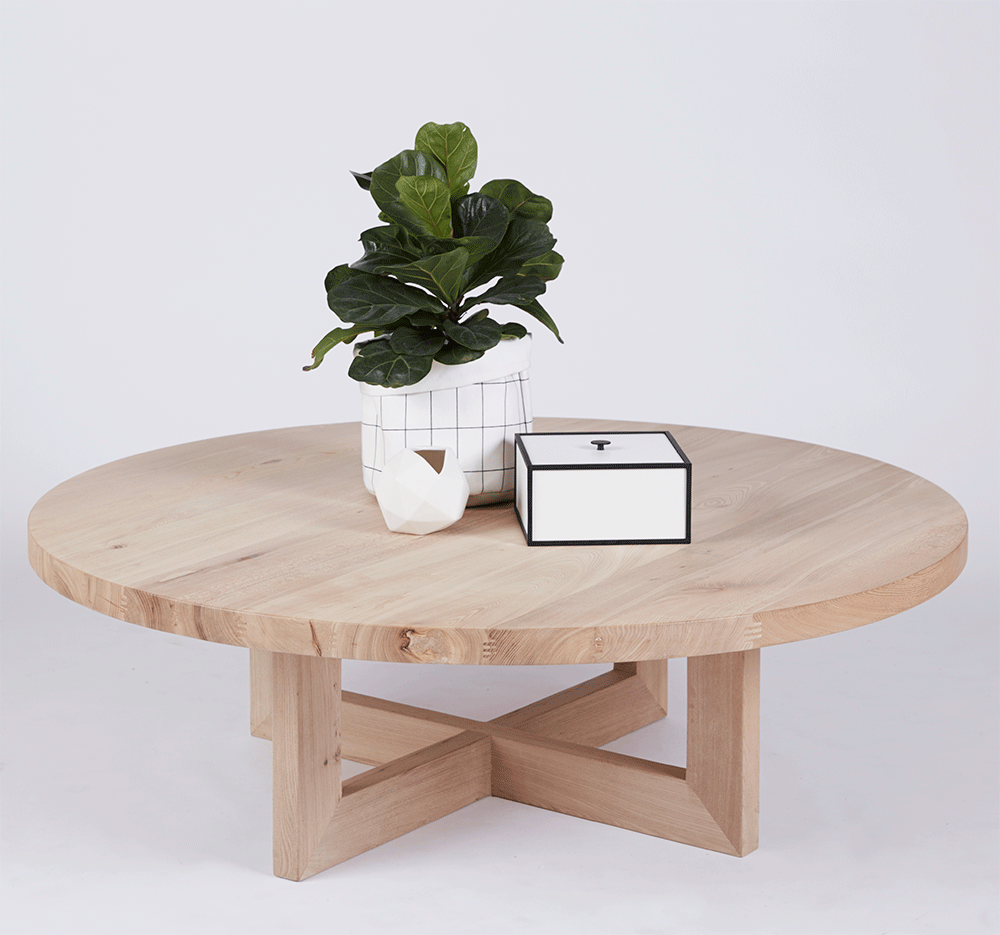 The Bondi Round Elm Wooden And Timber Coffee Table Sitting On Top
