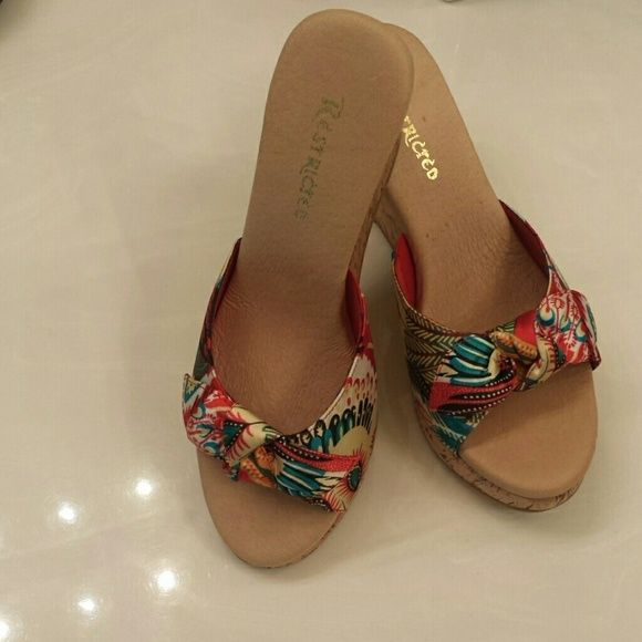Shoes Restricted multi-color sandal.  Padded footed and corked heel.  Shoe has never been worn. Restricted Shoes Sandals