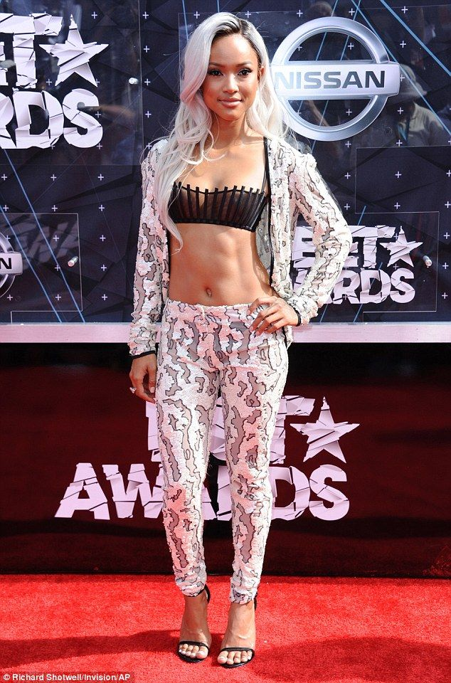 Look at me, too: The model showed off new platinum locks and flashed plenty of flesh in hipster patterned pants and unfastened matching cropped top