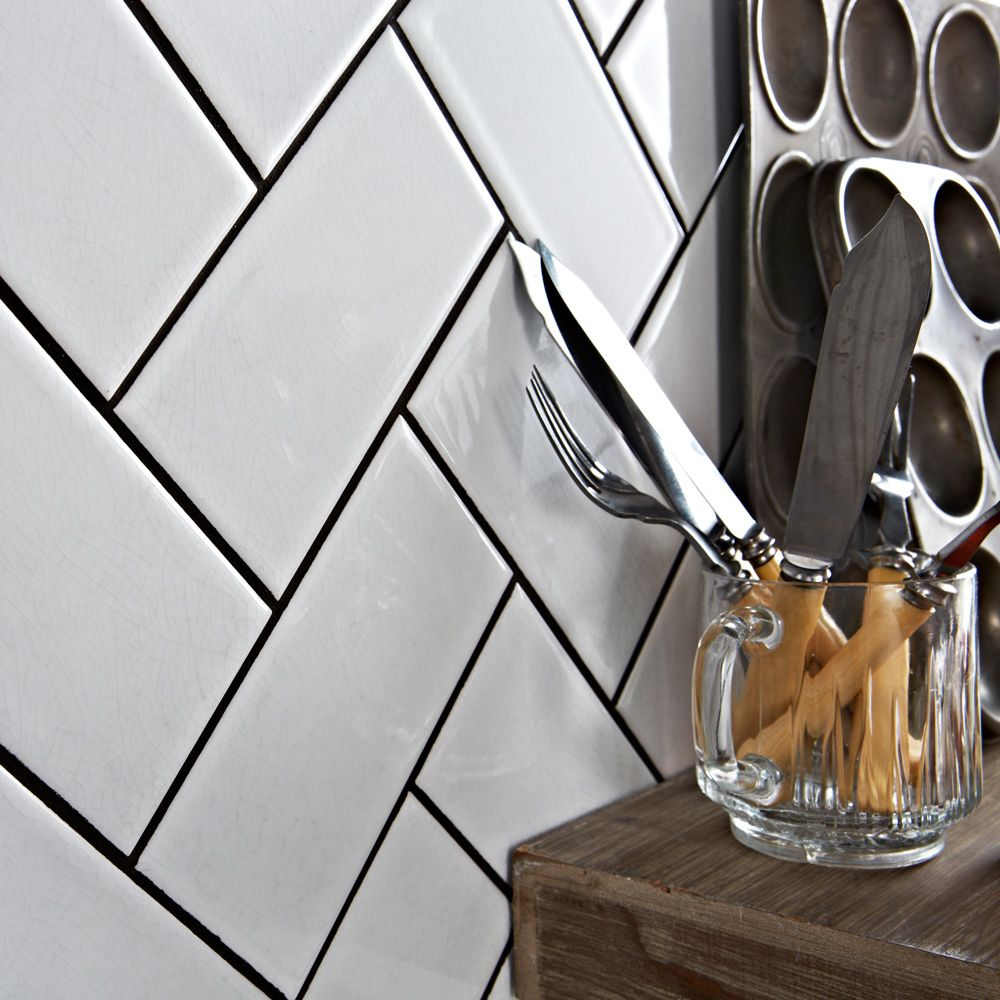 Looking for kitchen decorating ideas try making a herringbone these ceramic bastille white crackle metro tiles belong to our range of antique smooth crackle metro tiles and have a glossy finish these brick shaped wall dailygadgetfo Image collections