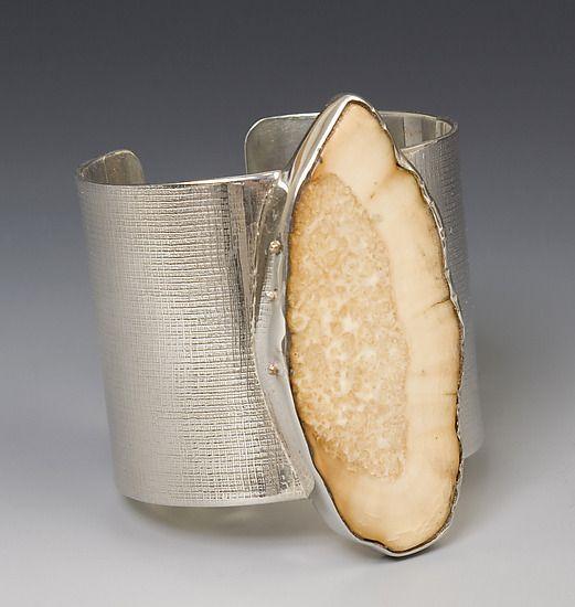 Cuff | Caroline Viene. Sterling silver and fossilized walrus ivory.