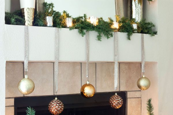 simple and elegant christmas mantel decorations garland tealights and ornaments hanging from ribbon - Christmas Mantel Decorations Garland