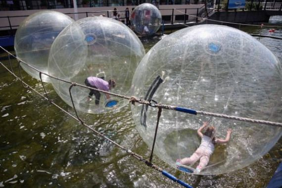 "Photo of Zorbing is an activity where people roll around in these ""orbs"" … and it's awe…"