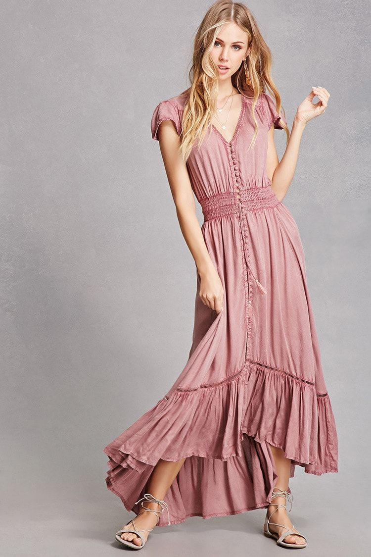 73011f3890b A woven maxi dress by Boho Me™ featuring a partial button front