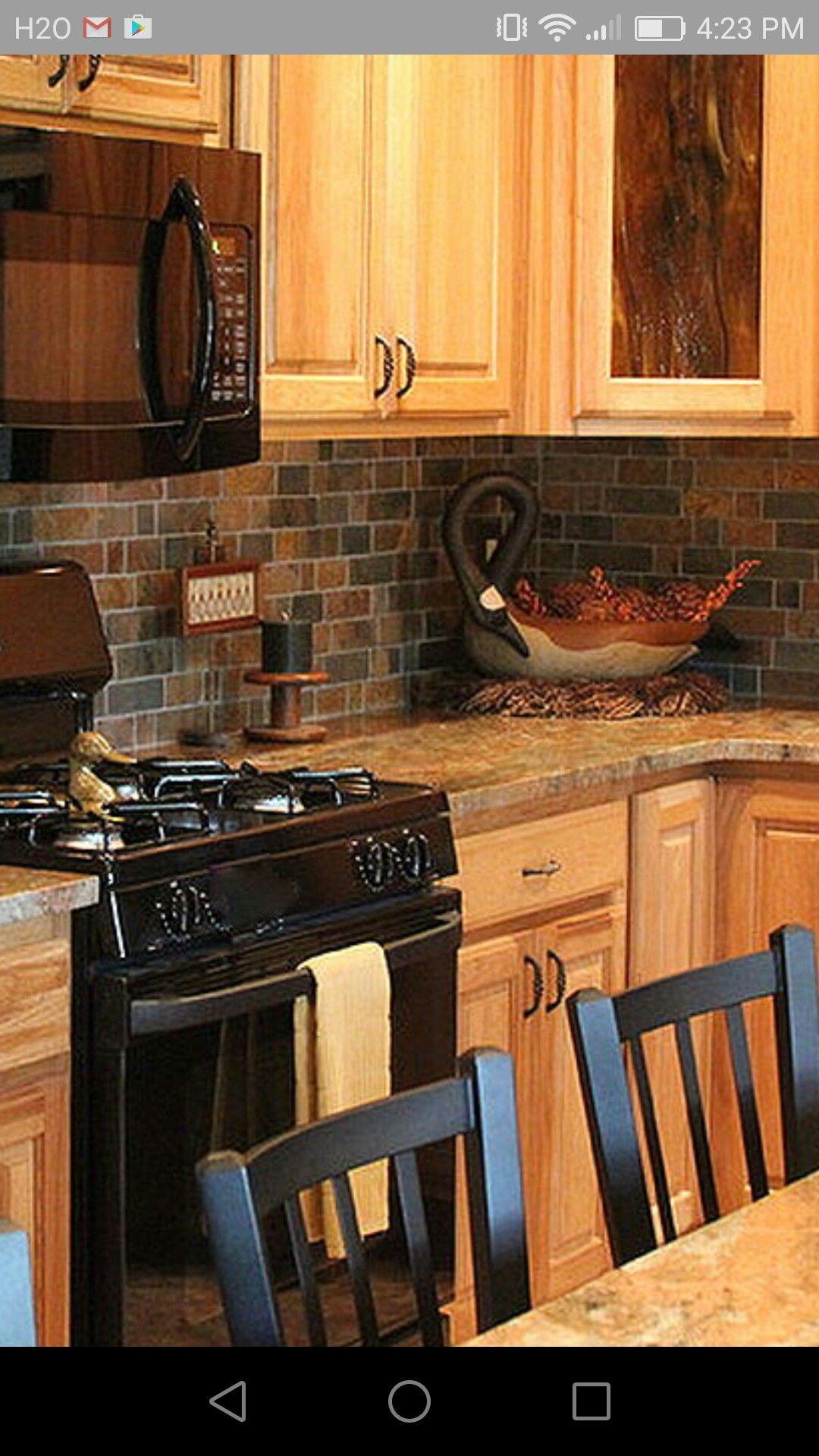 Oak Cabinets Black Appliances And Backsplash Rustic Kitchen