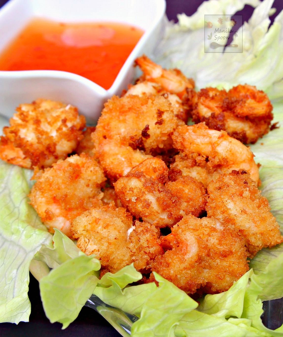 Camaron Rebosado is a citrus-marinated battered shrimp served with a sweet sour sauce and is the Filipino version of tempura. Cruncy-licious and flavorful, it's a great appetizer and a sure crowd-pleaser!