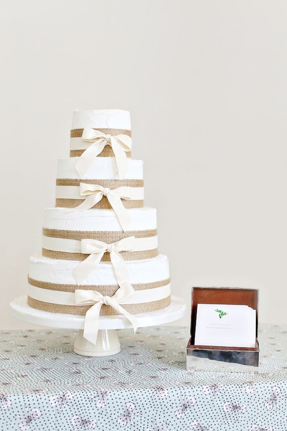 Simple wedding cake with burlap and bows.  Actually really sweet.  (I'm clearly in a burlap mood!)