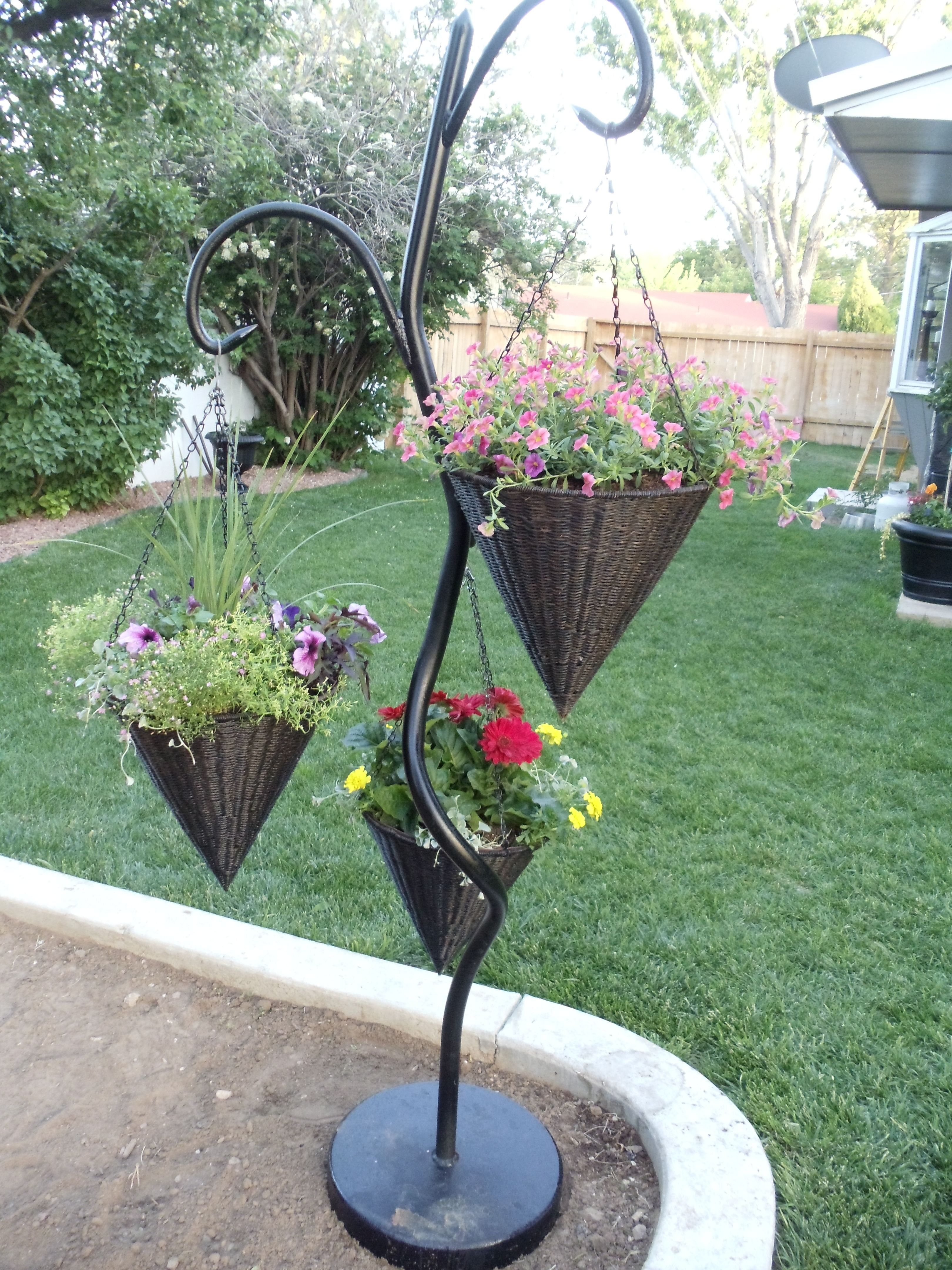 Welded Me A Stand For My Hanging Baskets Flower Garden Design Vertical Herb Garden Diy Garden Projects