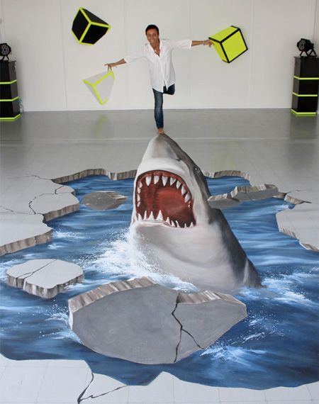 3-D Street art. The pics on this site are CRAZY. He's standing on a normal floor...what talented artists!