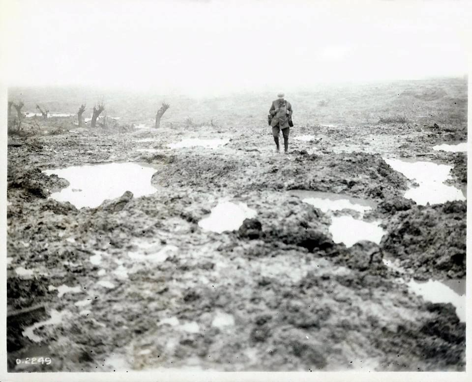 Canadian soldier standing in the mud at the battlefield of Passchendaele, Belgium, 1917. Photograph by William Rider.