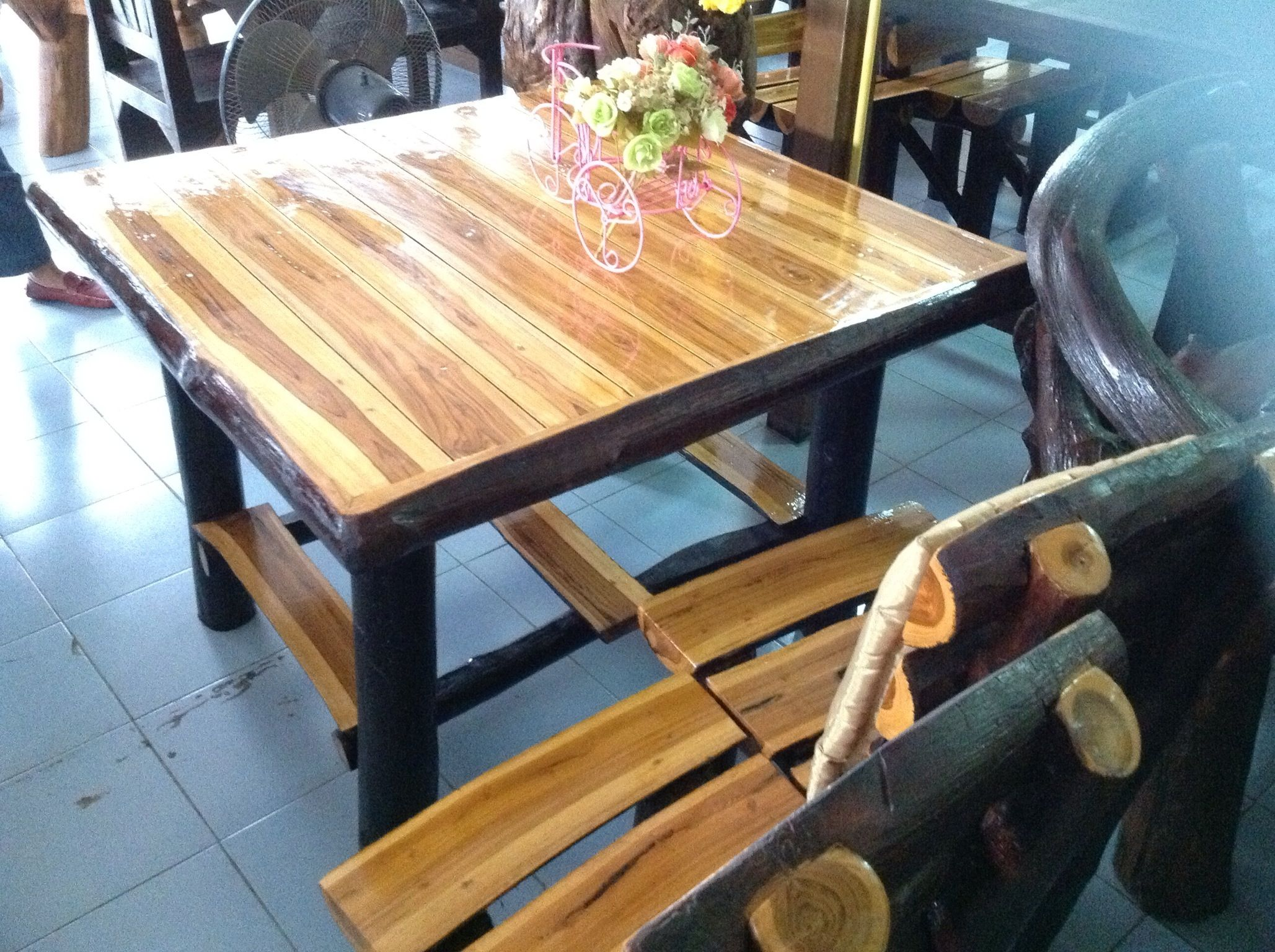 Handcrafted teak wood dining table from Chiang Mai Thailand