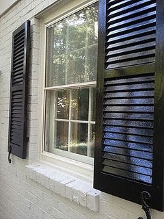 Glossy black exterior shutters: [...] He advises using this money ...
