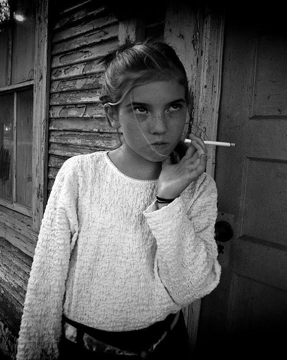 Chicks smoking black cigarettes — img 1