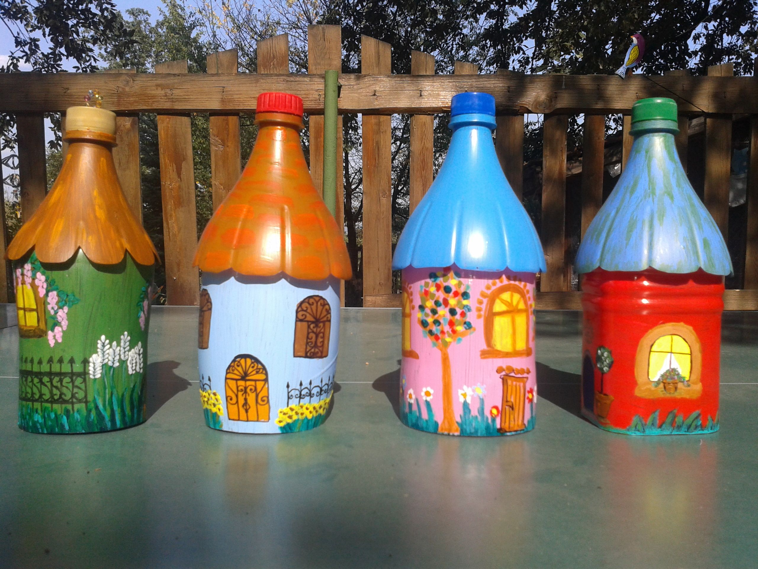 DIY soda bottle birdhouses are easy to make with your grandchildren