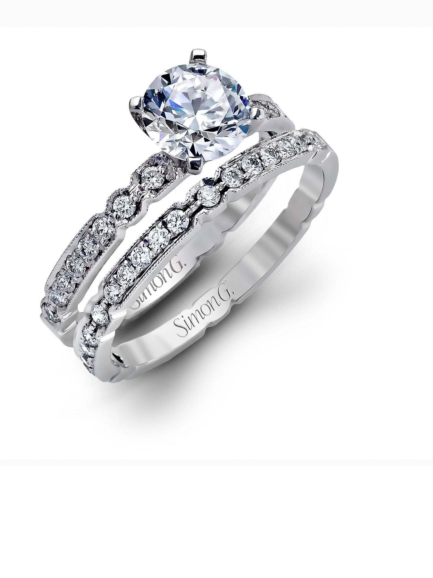 How stunning is this white gold engagement ring and wedding band set