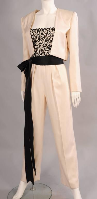 f4fde2cd938 For Sale on - A cream lace bodice is embellished with narrow black satin  ribbon and white sequins. The pants are all silk.