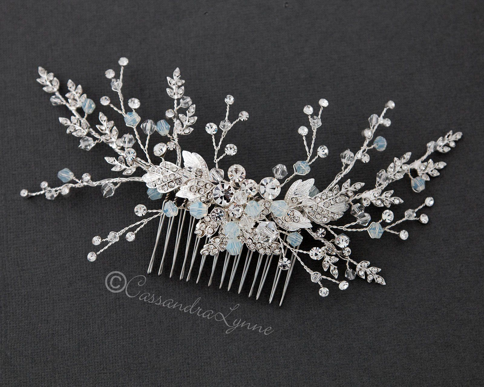 f71136db3 White opal and clear crystal beads adorn this dainty bridal hair comb.  Sprays of tiny jeweled leaves, beads and round cut stones reach out from  larger ...