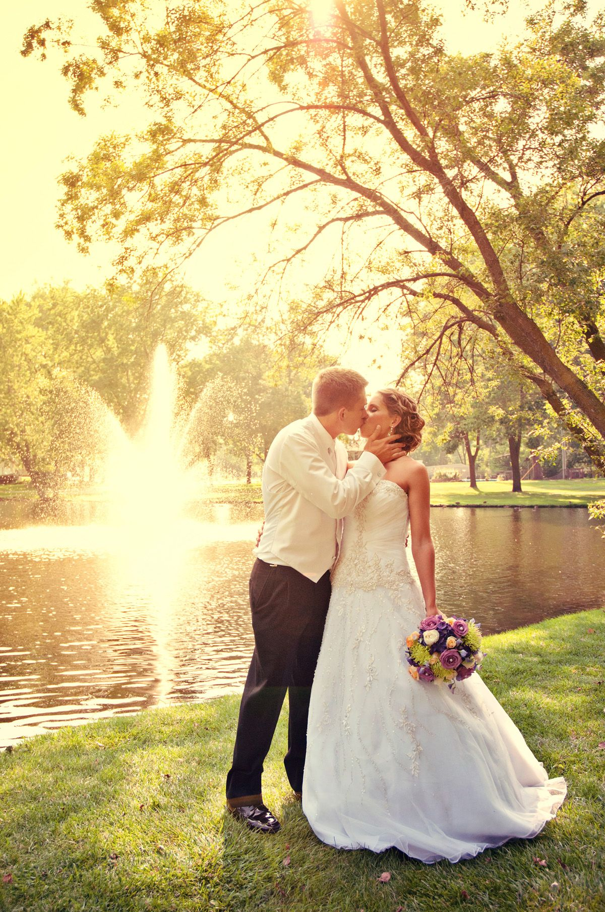 So beautiful with the fountain in the background! Photo by Sarah M. #weddingphotographersMN #summerwedding