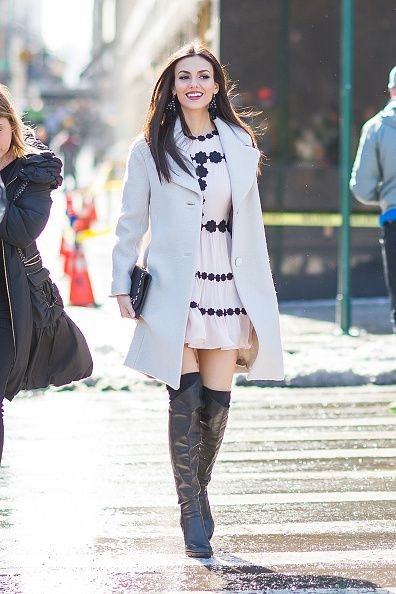 Actress Victoria Justice is seen wearing Kate Spade jacket and dress with DKNY boots in Midtown on February 10 2017 in New York City