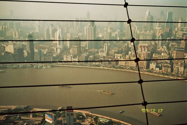 A view of the Huangpu river, the Bund and greater Shanghai from the top of The Pearl TV tower, Shanghai, 2005.