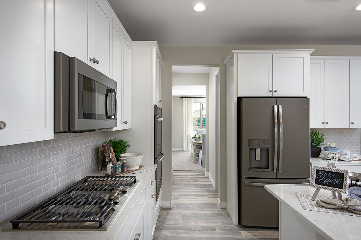 Slate Appliances Lend Contrast To A White Kitchen Raleigh Model