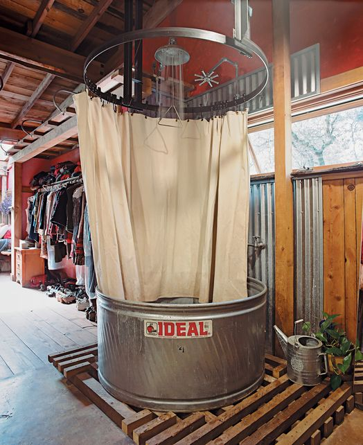 cattle tank shower...cute for an outdoor shower by the pool!!