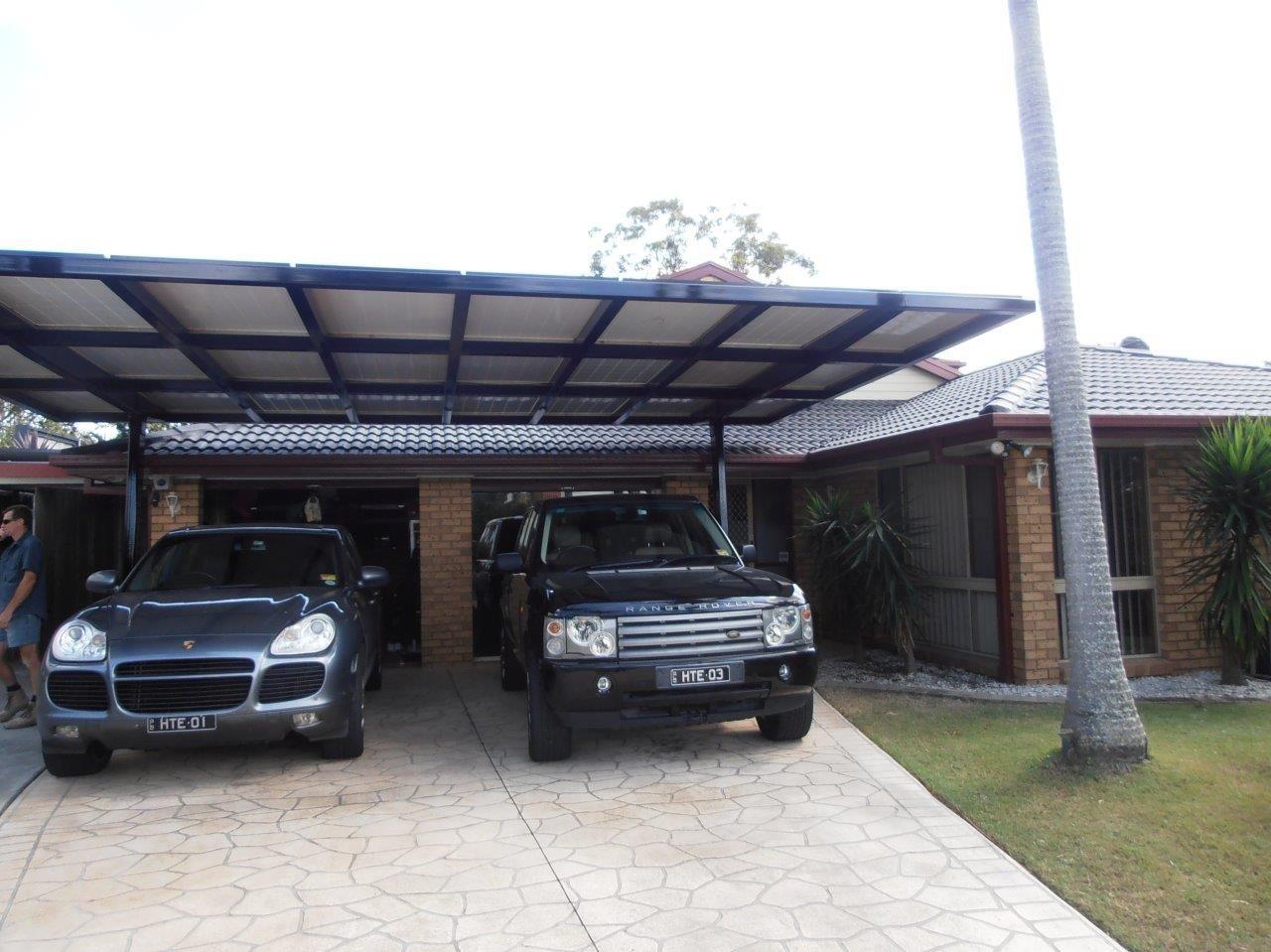 Carport Solar Panel Structure Cantilevered Steel Carport Doubles Up As A Solar Panel Structure Providing E Pergola Pergola Designs Pergola Attached To House