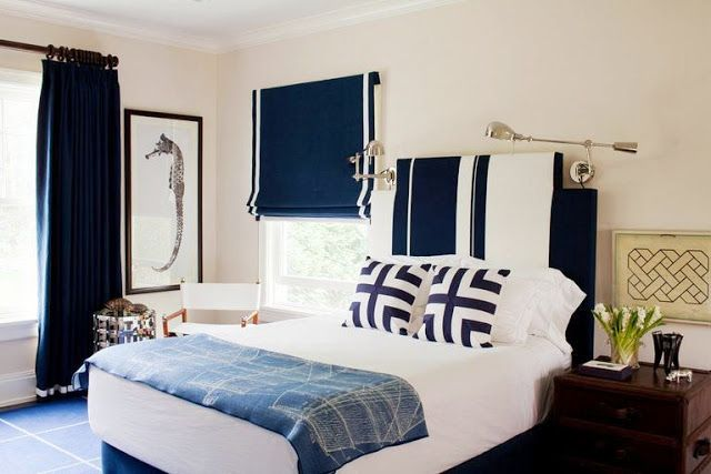 A Navy And White Bedroom With Bold Striped Upholstered Headboard Roman Shades Trimmed In Has Nautical Feel To It