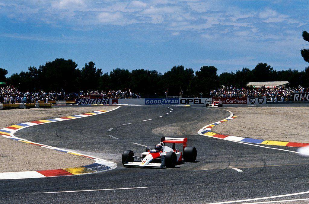 Alain Prost S Mclaren 11 Weaves Through Virage Du Camp On His