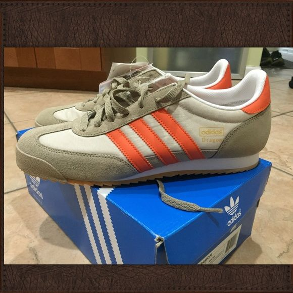 Men's Adidas shoes Orange and beige men's adidas shoes. Size 9 in men's brand new never worn! Comes with box. Adidas Shoes Sneakers