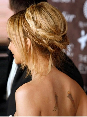 braided updo and wing tattoos