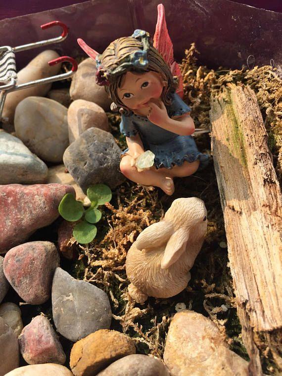 Miniature fairy garden fairy holding a cute gem fo