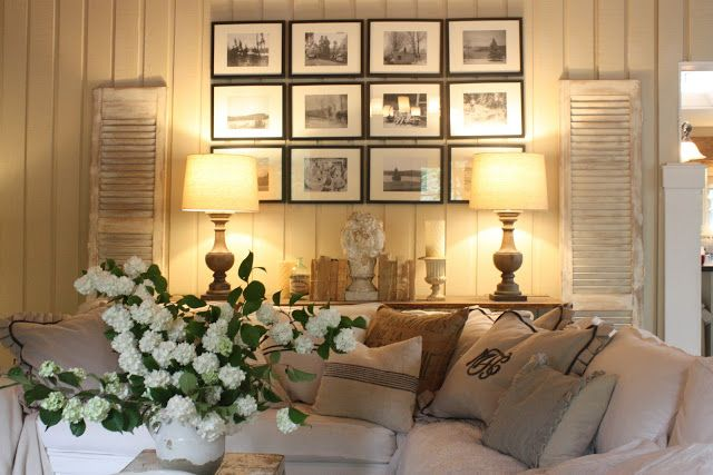 I LOVE the display behind the couch. The pictures, shutters and ...