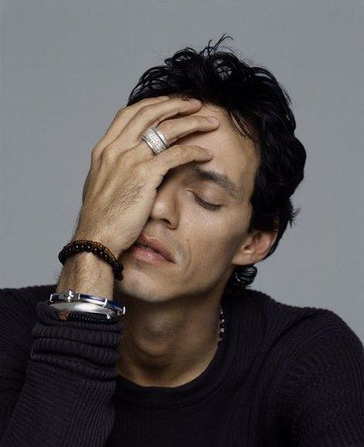 Marc Anthony because his voice has so much passion and his body language is soo flirty...