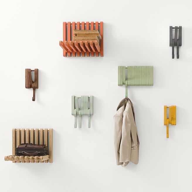 The Juhana Myllykoski Hidden collection for Sculptures Jeuxincludes a series of solid wood shelves and hooksthat can be rotated40 degrees to support heavier weights.