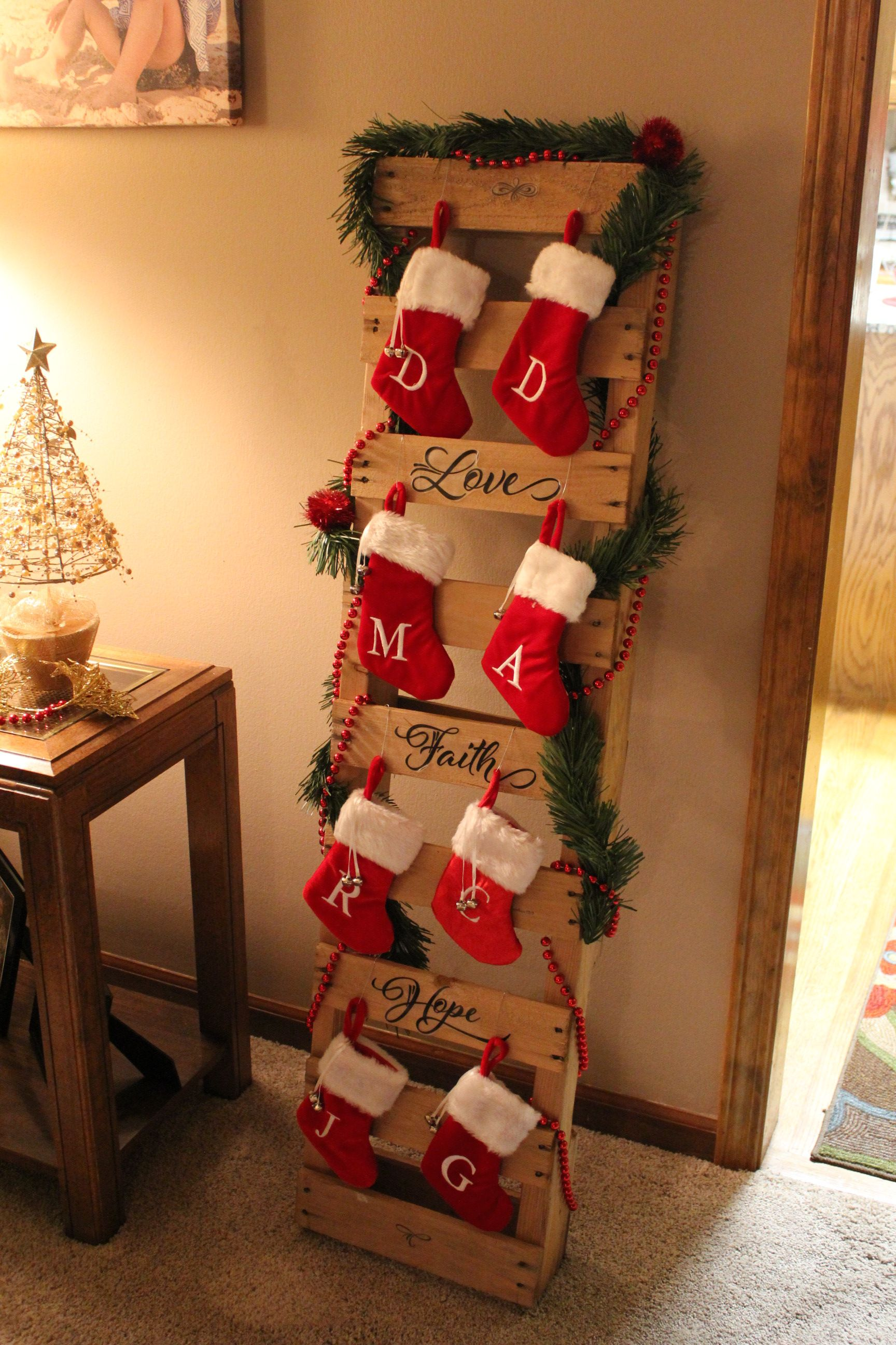 A pallet turned into a stocking holder. Cheap christmas diy