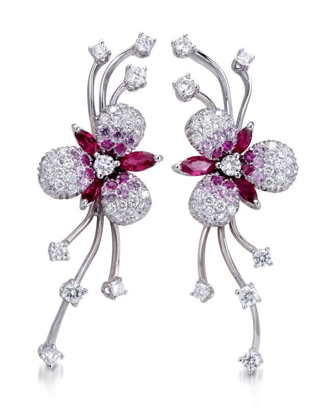 A pair of 18K white gold flower-shaped earrings, set with pink sapphires, diamonds and rubies by Stefan Hafner