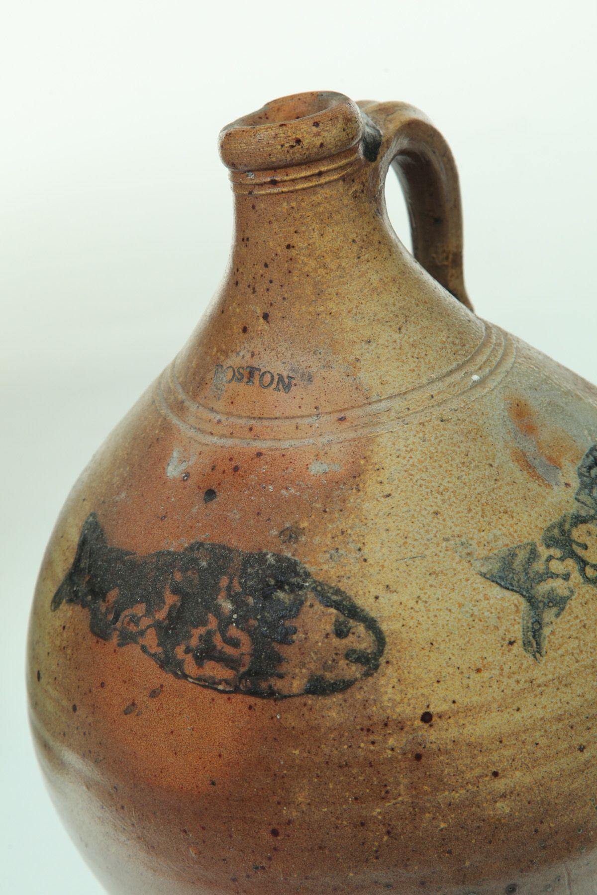 "Sold for $3,000 DECORATED STONEWARE JUG.  Impressed mark ""Boston,"" probably Jonathan Fenton, ca.1800. Ovoid form with three brushed cobalt codfish. 15""h."