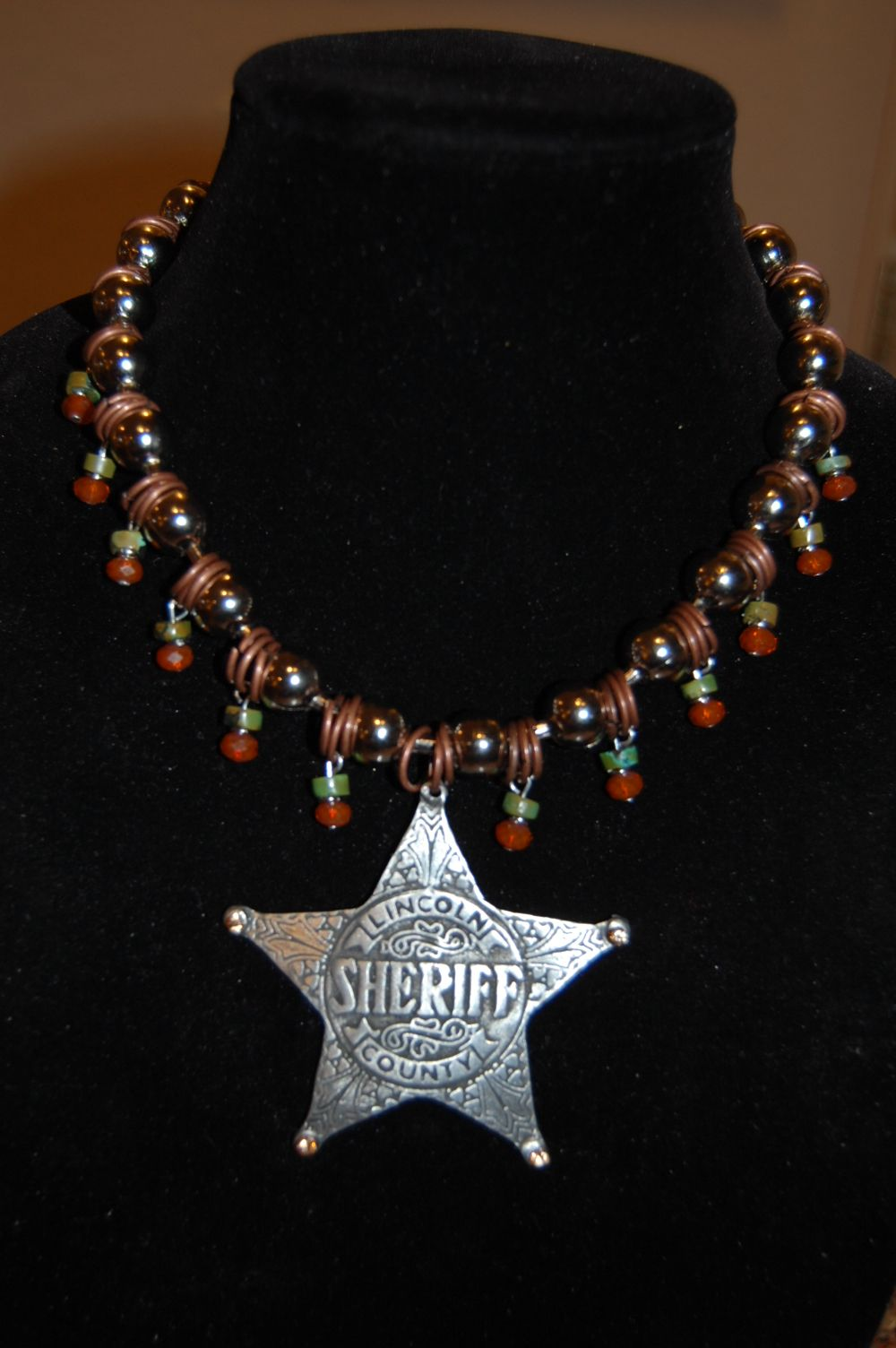 Menono Designs - Upcycled Sheriff Badge with turquoise & orange crystals.  Find us on facebook.