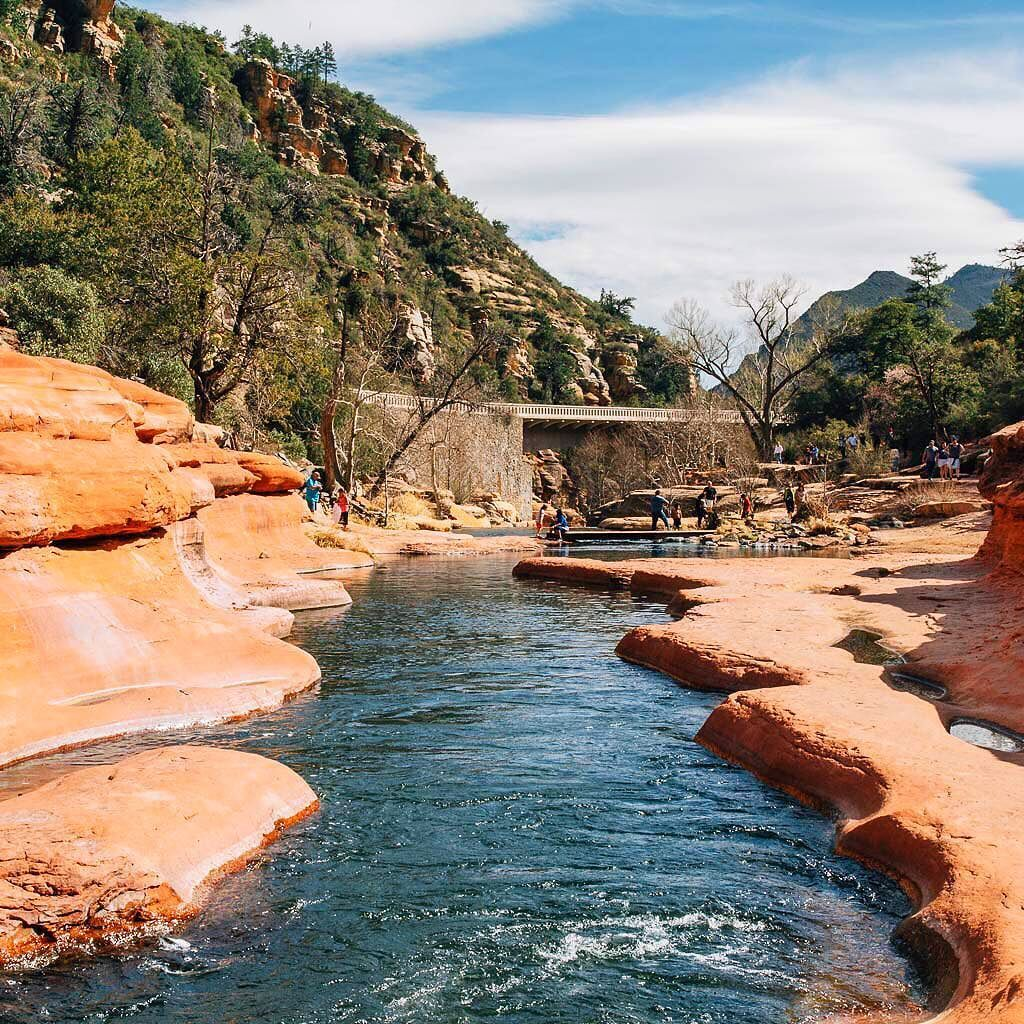Slide Rock State Park is no secret to anyone familiar with Sedona nevertheless it is still worth a visit. Here the river has worn a narrow path through the red sandstone creating mini cascades fast moving chutes and whirlpool wells.  Basically it's an all-natural water park. What's not to like?  Parking here is a bit pricey but we scoped out an free alternate parking spot. Check out our Guide to Sedona Swimming Holes for full details. Link in profile #visitarizona #explorearizona #exploreaz…