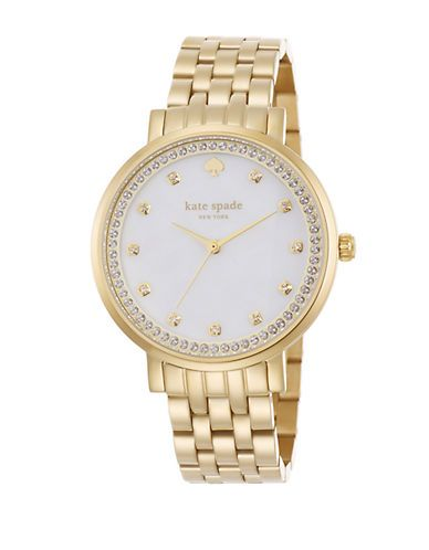 From the Monterey Collection. This sophisticated timepiece is beautifully designed with a white mother-of-pearl dial and enhanced with sparkling Swarovski crystals in gleaming goldtone.