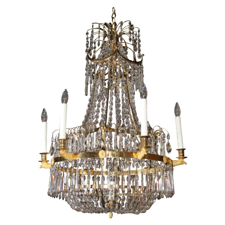 A six light crystal and ormolu Baltic chandelier having a central light with eagle head candle supports; the upper tier is starburst of ormulu with cascading crystal drops - formerly from the estate of Ariane Dandois.