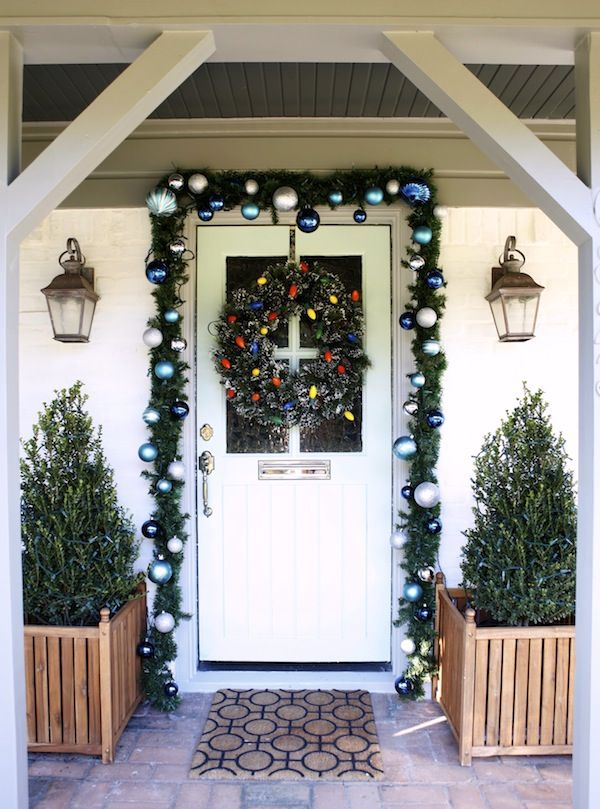 A flocked wreath with retro colored lights create a fun and vintage vibe for the #holidays #christmas | From The Home Depot's Apron blog series Holiday Style Challenge and Kyle of Knight Moves