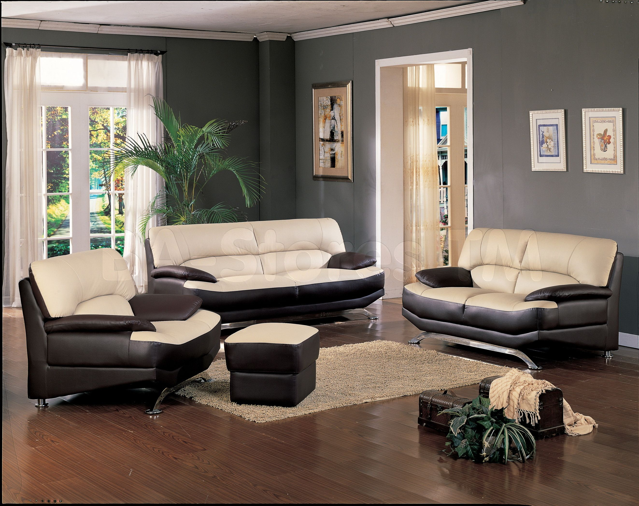 Cream and brown living room designs - Black And Cream Leather Couch On Dark Brown Wooden Floor Completed By White Fabric Window Curtain Living Room