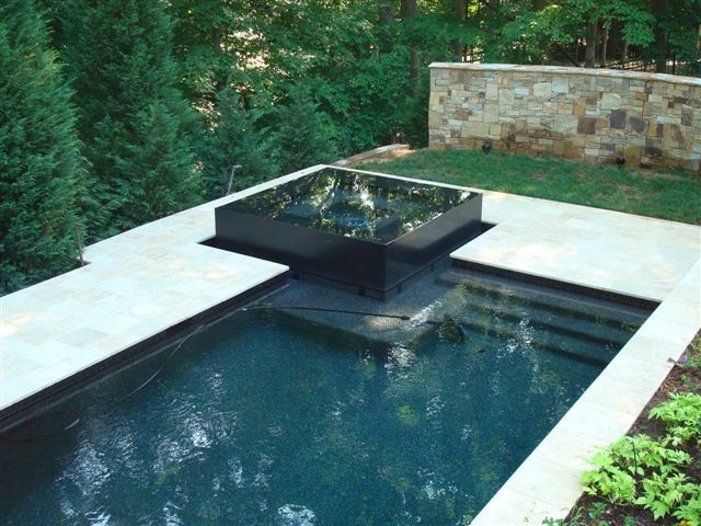 Concrete geometric pool with raised spa backyard for Raised pool designs